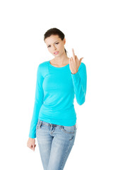 Young woman showing middle finger