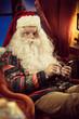 Santa Claus using smartphone
