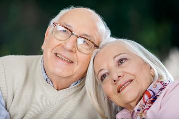 Loving Senior Couple Looking Away