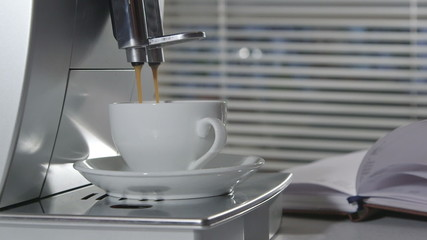 Man making cup of espresso using coffee machine