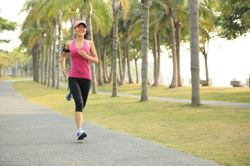 woman runner athlete running at tropical park