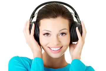Portrait of a woman with big headphones