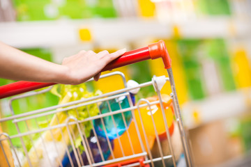 Woman at supermarket with trolley