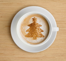 coffee cup with foam and christmas tree shape