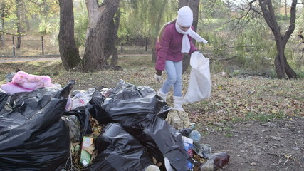 Clean up garbage in public park after holiday weekend