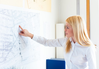 Young female architect at office