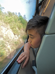 boy by the train window