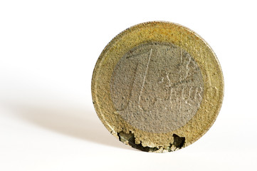 One euro coin crumbles under the strain of the economic crisis.