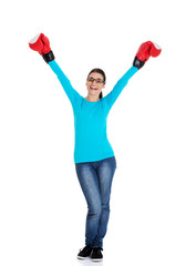 Attractive young woman wearing boxing gloves