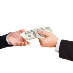 Businessman giving money cash dollars in hands