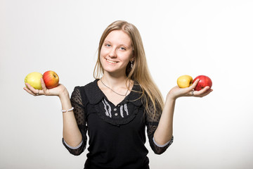 Smiling girl with apples.