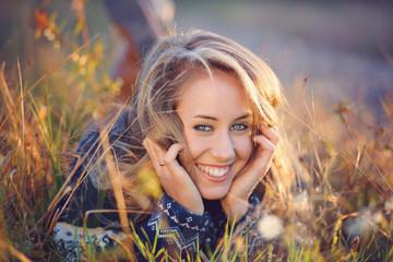 Beautiful happy woman smiles