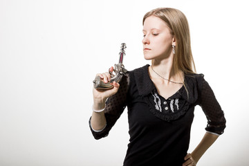 A girl with revolver.