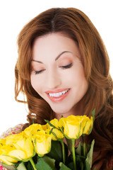 Portrait happy woman holding bunch of roses