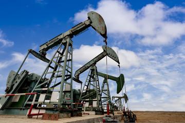 Working oil pump jacks on a oil field