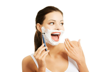 Portrait of happy woman shaving beard