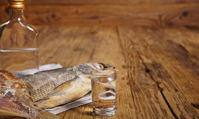 Russian snack . Dried fish on old newspaper