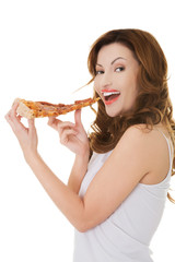 Side view of a woman eating pizza