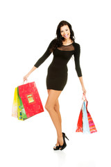 Full length woman with a lot of shopping bags
