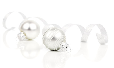 white christmas decoration balls with satin ribbon, isolated on