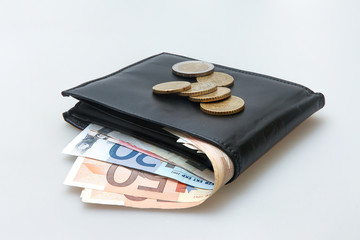 Black leather wallet with Euro notes and coins