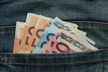 Various Euro notes in Jeans pocket