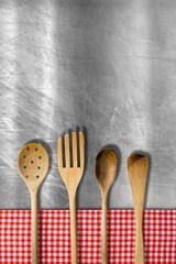 Wooden Kitchen Utensils on Metal Background