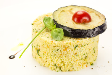 couscous embellished with eggplant and tomato
