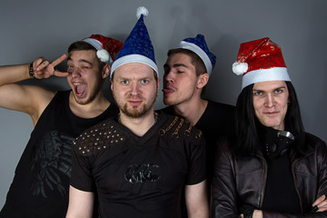 The man's metal band in christmas hats