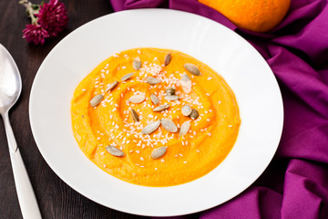 Pumpkin cream-soup with seeds in a plate