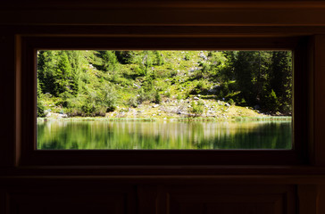 Wood windows with a lake view