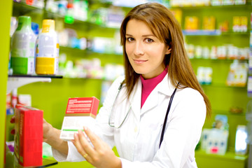 Smiling female pharmacist at work
