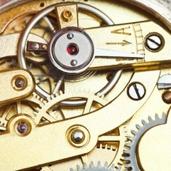 brass mechanical clockwork of retro watch