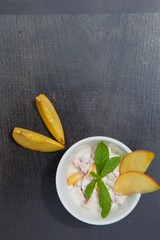 Homemade peach yogurt in a white dish