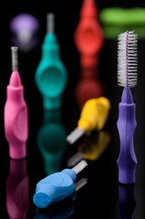 Multicoloured dental brushes