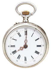 eight o'clock on the dial of retro pocket watch