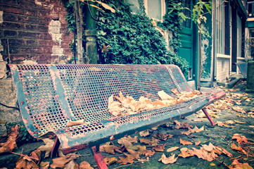 Bench in a street in autumn,vintage process