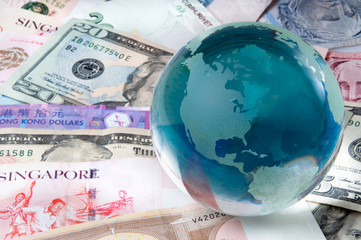 Global Finance World Money Currency Notes and Globe