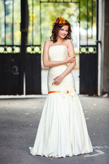 Happy bride with autumn bouquet