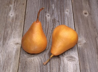 Two kaiser pears on wooden background