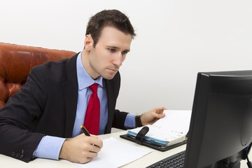 Concentrated business man filling a paper document