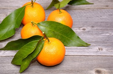 Mandarin or tangerine fruit isolated on wooden background