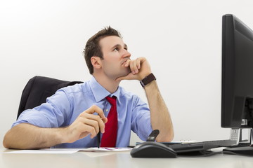 Worried manager thinking of business solutions at work