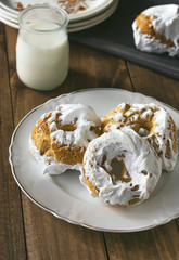 Meringue donuts served with a glass of milk