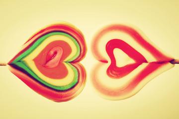 Colorful heart shaped sweet lollipops