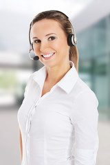 Young business woman in headphones and microphone.