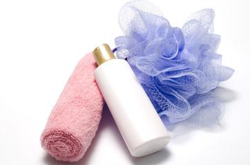 bath puff liquid soap and towel