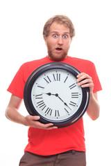 Surprised bearded man holding big clock