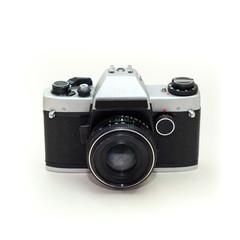 Retro photo camera isolated on a white background