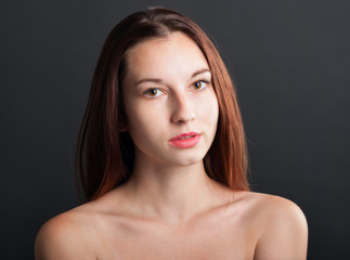 close-up portrait of beautiful serious woman